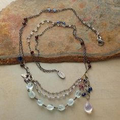 Fantasia Necklace - Jes MaHarry aquamarine, chalcedony, garnet, kyanite and blue sapphire. A lilac quartz drifts to the side. Sterling silver and 14kt gold. Lobster clasp. sundance catalog -- sigh.....