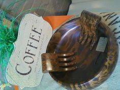 This piece, salad bowl with hands is made from mango wood, it is beautiful.  We have many other pieces too at The Chicken House, Griffin, Ga.  You can see more at www.chickenhouseconfitures.com  we are located at 324 E. Broad Street inside The Broad Street Mill.  The Mill was built in the 1920's and is a vintage/industrial dream....full of original items!