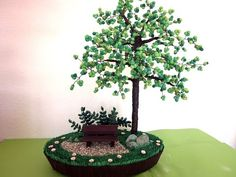 Dieses Video ist auch in Deutsch zu sehen: . This pearl tree is an original creation that has arisen from paper beads, wire and wooden sticks. To this idea I came when I held three paper beads Quilling Videos, Quilling Craft, Quilling Techniques, Quilling Flowers, Quilling Patterns, Quilling Designs, Beaded Flowers, Paper Flowers, Origami Flowers Tutorial