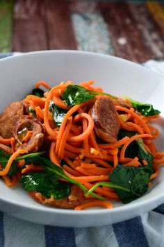 Spiralized sweet potato noodles, smoky sausage and tender spinach.
