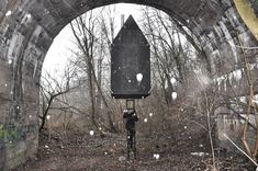 Completed in 2016 in Czech Republic. Images by Tomáš Rasl,  Martina Kubešová. Black flying house hovers under the arch of the old railway bridge. Attracts attention, entices you to visit and raises questions. Black flying house...