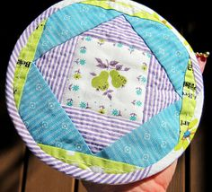 Round Pouch B & PDF Tutorial by elnorac - this is a pouch template and tutorial but I think it would make super cute hotpads