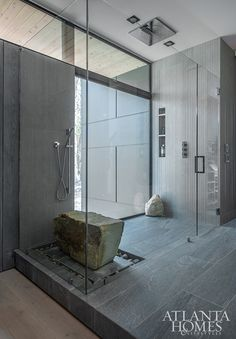 """Instead of flooding a shower space with excessive accessories and gadgetry, architect Scott West kept it clean, adding only a """"boulder"""" seat that the homeowners found at a local landscape shop. Custom Leather Sofa, Organic Interiors, Walker Zanger Tile, Modern Bathroom, Modern Design, Custom Vanity, Wood Like Tile, Sunken Bath, Cool Stuff"""