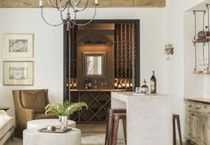 You don't have to be a wine snob to appreciate the beauty of a home with a built-in wine cellar. Read on for our wine cellar must haves! Wine Storage, Wine Cellar, Oversized Mirror, Living Room, Interior Design, Building, Wine Rooms, Furniture, Interiors