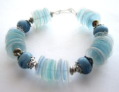 Upcycled blue bracelet made of recycled plastic bottles with blue chunky beads