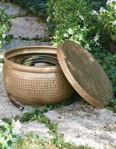 """Our Delilah Hose Pot is designed to make storing your garden hose easier… and more stylish; you'll be able to store up to 100 ft. of 1/2"""" dia. hose inside. An integrated port allows you to more conveniently connect to your water source; pot also features drain hole. Garden Oasis, Garden Hose, Water Sources, Grandin Road, Flower Boxes, Connect, Store, Stylish, Window Boxes"""