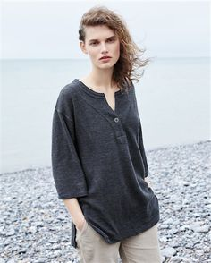 Poetry - Cotton and linen jersey tunic - In a range of soft marled colours, this tunic length, slightly heavier weight cotton and linen top has colour blocked side panels that run from the sleeves to the hem. With three-quarter length sleeves, the neckline closes with a single button on a statement stitched placket. 65% cotton 35% linen