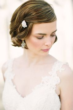 A chin-length bob is all the more sophisticated with curled-under ends. Keep side-swept bangs at bay with a dainty barrette.