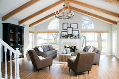 From shiplap and wood support beams to exposed brick and floor-to-ceiling windows, discover the best Fixer Upper living room ideas and designs ever created.