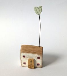 Little wooden home with a clay heart