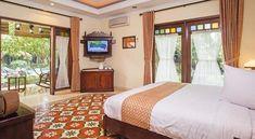 kamar tidur Duta Garden Hotel di Jogja luas dan nyaman