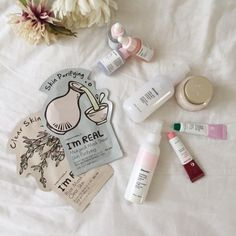 tonymoly i'm real sheet masks, glossier soothing face mist, glossier lip balms in cherry and rose, skinfood facial water vita-c cream, glossier milky jelly cleanser, and glossier super serums