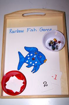 Rainbow Fish Math Game (Photo from The Princess and the Tot) Rainbow Fish Eyfs, Rainbow Fish Activities, Ocean Activities, Book Activities, Preschool Activities, The Rainbow Fish, Rainbow Water, Preschool Education, Preschool Classroom