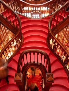 """Livraria Lello & Irmao, Porto, Portugal: """"This gorgeous, 100-year-old bookstore is known for its stunning architecture and 'stairway to heaven.'"""""""
