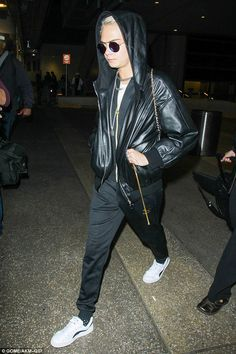 Show your sporty side in a pair of track pants like Cara's. Click 'Visit' to buy now. #DailyMail