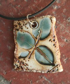 Rustic Teal Leaves Porcelain Pendant 2 by muddyfingers on Etsy, $16.00