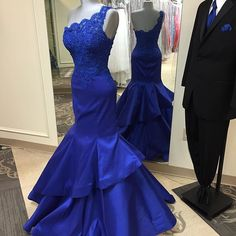 Royal Blue Floor Length Satin Mermaid Prom Gown Featuring Lace One Shoulder And Tiered Skirt
