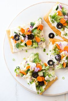 Cold Vegetable Pizza - This cold veggie pizza recipe is made with crescent rolls, cream cheese, ranch dressing and lots of fresh veggies. It's the perfect party appetizer or fun family meal! Try it with Marzetti Ranch Veggie Dip.