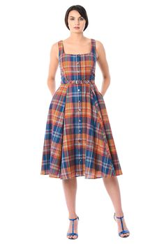 A self-belt beautifully cinches in the seamed waist of our feminine cotton check shirtdress styled with a tank bodice and full flare skirt. #bestskirtforyourbody