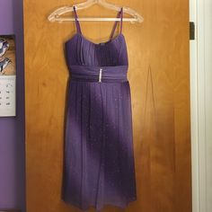 Dress Light and dark purple sparkly dress! Super cute! With a beaded emblem in the middle Ruby Rox Dresses