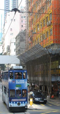 Things to see from the tram in Hong Kong- other trams and bamboo scaffolding which is amazing stuff, flexible, eco friendly, each joint is hand tied.