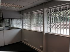 RSG1000 retractable security grilles fitted to an industrial estate in Reading.