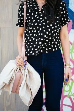 Pair polka dots with high waisted denim for a retro vibe.