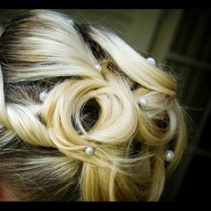 I really like the idea of putting pearls in my hair like this, but I'd rather have them woven into the hair in front, leading back towards an updo