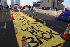 """Posted 12 December 2014. Booted From Occupy Central, Hong Kong's Pro-Democracy Protesters Take on New Battlefields. There were more than 100 """"We'll be back"""" banners hanging at the Admiralty protest site before then police clearance on December 11, blogger Au Ka Lun observes."""