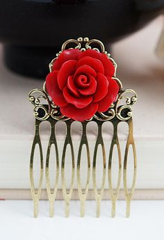 Red Rose Bridal Hair Comb with white feathers and red shoes