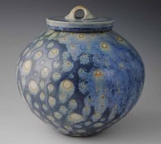 Really striking piece. Strong form with a surface to match. This large lidded vessel was fired in a salt kiln, which helped give it all that
