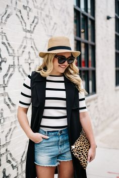 Styling denim cutoffs in your late twenties can be tough. This long black trench vest is perfect piece to feel confident in a pair of short jean shorts.