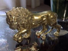 A baroque golden lion from Gabrielle 'Coco' Chanel's apartment - @~ Watsonette