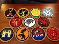 Complete Game of Thrones Coaster Set hama perler beads - Set of eleven coasters based on house sigils from Game of Thrones Includes: Bolton, Greyjoy,Tyrell, Arryn, Lannister, Stark, Targaryen, Frey, Baratheon, Tully, Martell by hamallama