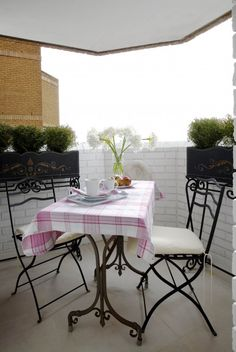 Small Balcony Garden Ideas. I love this for my small balcony! Maybe a few plants, a small rug ... hmmm!