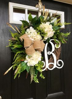 Gorgeous Elegant Year Round Door Wreath! Perfect for greeting your guests to your home with this one of a kind door wreath. Made up on an 18 grapevine wreath with moss, mixed flowing greenery of ivies, boxwood, eucalyptus, hydrangeas leaves, ficus leaves, green hops and ferns.