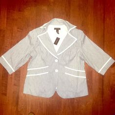 Lane Bryant Sz 18 Gray White Trim Faux Leather NWT BRAND: Lane Bryant SIZE: 18  DETAILS: ~Fully lined- Brushed striped look- Slight linen texture ~Oversized pockets ~White faux leather trim ~Two button closure- 3/4 sleeve length   Retails for $89.00 Lane Bryant Jackets & Coats Blazers
