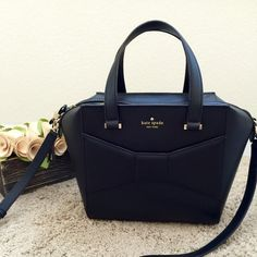 """Kate Spade 2 Park Avenue Beau Gently used a few times. This is the beautiful Kate Spade 2 Park Avenue Beau Tote in black - size small. Gold hardware. Measures 10"""" x 15"""" x 9.5"""". Condition: mild scuffs on the exterior leather, faint scratches on the metal feet bottom, and a mild crease at the top of the bag as seen in picture 4. Inside the bag is pristine. Comes with the dust bag and care card. Retails $428 + tax. Please ask questions and I welcome offers!  kate spade Bags Totes"""