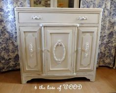 WOW....who knew you could use an old picture frame as an applique to change the look of a piece of furniture!