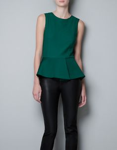 EMBROIDERED FRILL TOP by Zara - love the emerald green peplum top against the black leather-esque bottom.