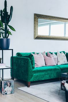 Blogger Who is Mocca updated her IKEA Stockholm sofa with a Bemz cover in Emerald Zaragoza Vintage Velvet from our collaboration with Designers Guild | green velvet sofa | glamorous living room with gilded mirror and cactus | Fashion blogger Who Is Mocca's fabulous living room