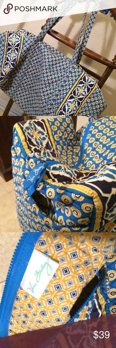 Vera Bradley XL blue and yellow duffel travel bag Vera Bradley designs - blue and yellow sunflower pattern. Two long shoulder straps/handles and one pocket on the outside of the bag for more storage. XL duffle fits carry on requirement for air travel and can fold up small for storage 🌻 no damage or stains - perfect condition! Vera Bradley Bags Travel Bags