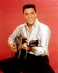 Rock and roll musician Elvis Presley strums an acoustic guitar while posing for a portrait in September 1962 in Culver City, California at MGM Studios. Get premium, high resolution news photos at Getty Images Christmas Playlist, Favorite Christmas Songs, Christmas Fun, Vintage Christmas, John Lennon, Party Playlist, Editorial, Solo Music, Best Guitarist