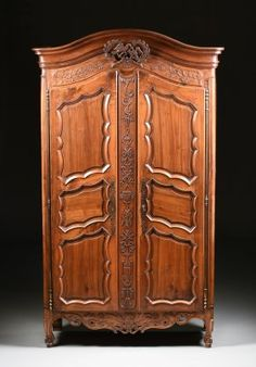 ~ A Large French Provincial Carved Cherry Armoire ~ liveauctioneers.com