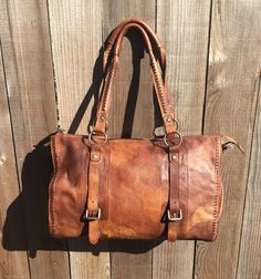 Great leather tote bag. Perfect to carry all your items for a short trip or as a carry all on your flight home.  Can fit an approx. 14 inch laptop, has several internal pockets, and adjustable strap, and leather handles.    Comes in a distressed brown color.     Details:  -Material: 100 %Genuine Leather  -Dimensions: 17 inches(L) 5 inches(W)  6 inches(H)    -Weight-2 pounds    -Shoulder Strap : adjustable                | Shop this product here: http://spreesy.com/LadyBagsSF/9 | Shop all of…