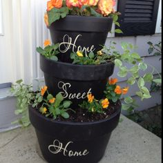 I made one!!!!  Soo easy.. Just paint pots with black acrylic paint, apply vinyl letters and plant flowers!