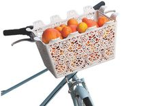 I am on the market for a bike basket - if only this pretty one were a little more roomy...