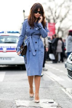 Miroslava Duma in a powder blue trench belted to the side and paired with nude pumps