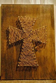 Cross Wood Nail and String Art. I recently made a nail and string art piece in the shape of Alabama. This would be a nice one to do, as well.