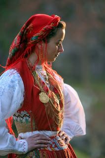Lavradeira costume--likely antique due to the decoration and embroidery style